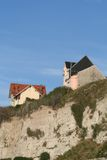 Houses on the cliff. Two houses at the edge of a chalkstone cliff Stock Image