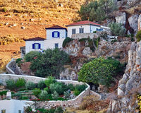 Houses on the cliff, Hydra island town, Greece Royalty Free Stock Photos