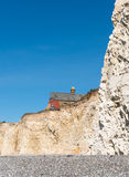 Houses close to cliff edge Royalty Free Stock Photo