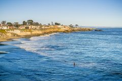 Houses close to the eroded Pacific Ocean coastline, Santa Cruz, California. Landscape in West Santa Cruz on a sunny evening royalty free stock photo