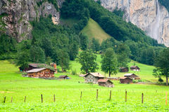 Houses close to a Steep Rocky Mountain Royalty Free Stock Image