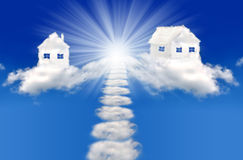 Houses in clouds Stock Images