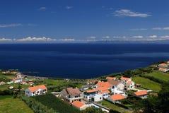 Houses on coast stock photos