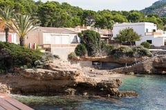 Houses on the coast of Majorca with sunshine.  Royalty Free Stock Photography
