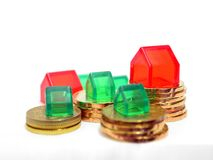 Houses and Coins Royalty Free Stock Images