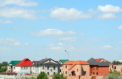 Houses with color roofs. On a background of the sky Royalty Free Stock Image