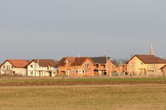 Houses in construction. In new neighborhood Royalty Free Stock Images