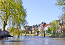 Houses at a course of a river royalty free stock image