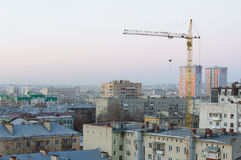 Houses and a crane in Saratov city Royalty Free Stock Images