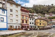 Houses in Cudillero. Colorful houses located next to each other near the trees of the forest. They are located in the Spanish town of Cudillero in Asturias stock images