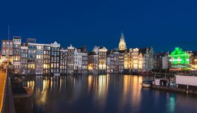 Houses on Damrak canal at night, Amsterdam, Netherlands stock images