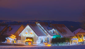 Houses decorated with christmas lights Royalty Free Stock Images