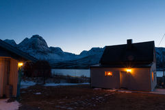 Houses with decoration lights near Svensby village in Norway dur Stock Photography