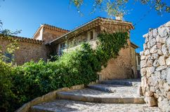 Houses of Deia, Mallorca, Spain. Romantic corner in the street of the Spanish village Deia. Village Deia in tramuntana mountains Mallorca Stock Photos