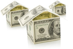 Houses from dollars on white isolated background Royalty Free Stock Photos