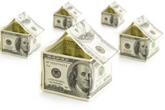Houses from dollars on white isolated background Royalty Free Stock Images