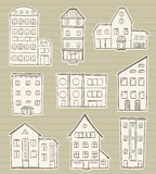 Houses doodle sketches. Set of houses doodle sketches on paper background Vector Illustration