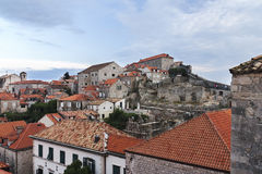 Houses of Dubrovnik near the wall. Houses and ruins of Dubrovnik near the wall Royalty Free Stock Image