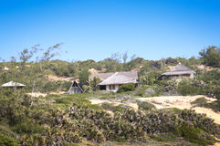 Houses in the dunes of Tofo. Houses with view of the Indian Ocean in the dunes of Praia do Tofo in Inhambane, Mozambique Stock Photos