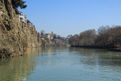 Houses on edge of cliff above river Kura, Tbilisi Stock Images