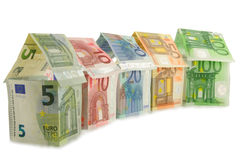 Houses of euro banknotes. Houses made from euro banknotes, five, ten, twenty, fifty, one hundred Royalty Free Stock Photography