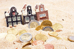 Houses and euro money in the sand Stock Image