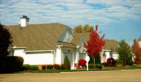 Houses in fall. Houses in sunny fall day Royalty Free Stock Photo