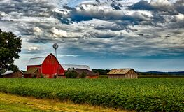 Houses in Farm Against Cloudy Sky Stock Images