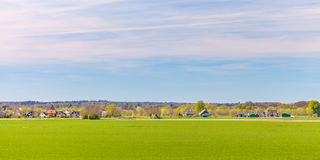 Houses and farms in front of the Dutch national park Veluwe Stock Images