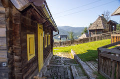 Houses, fences and stairs in Drvengrad, Serbia royalty free stock photos