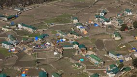 Houses and field in the Sherpa village Khumjung. Sad scene after the Earthquakes in spring 2015. Royalty Free Stock Photo