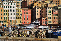 Houses and fishing nets. Fishing nets in the small port of Camogli, a small sea village near Genoa (north of Italy). Colored houses with typical ligurian style Royalty Free Stock Images