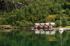 Houses at the fjord shore, Norway. Four small wooden houses at the fjord shore, Norway Royalty Free Stock Photos