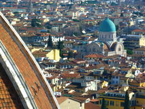 The houses of florence. A roof top view of houses in the historic and beautiful city of florence. different colours from red, yellow and light blue Royalty Free Stock Images