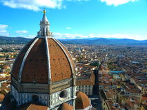 The houses of florence. A roof top view of houses in the historic and beautiful city of florence. the il duomo's tuscany red features in the foreground of the Royalty Free Stock Images