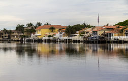 Houses in Florida reflecting on water Royalty Free Stock Images