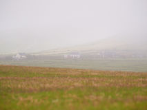 Houses in the fog. Houses in Dingle, Ireland, on a foggy and misty day Stock Image