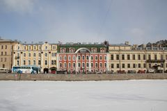 Houses on Fontanka embankment in winter in St. Petersburg, Russia stock photography