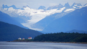 Houses at foot of glacier Stock Photo