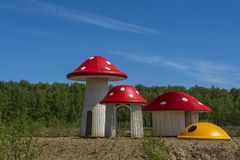 Houses in the form Of mushrooms fly agaric summer forest glade. Houses in the form Of mushrooms fly agaric forest glade stock photos
