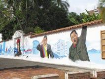 Houses with former Venezuelan president Hugo Chavez graffiti. Houses in Caracas with former Venezuelan president Hugo Chavez graffiti royalty free stock photos