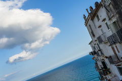 Houses in front of the sea. A white building in front of the see in Sperlonga, Italy Stock Photography