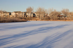 Houses and frozen lake in Colorado Stock Photography