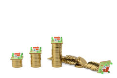 Houses and gold coins.3D illustration. Stock Photo