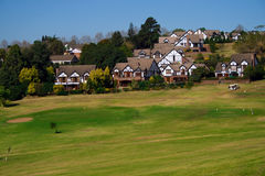 Houses on golf course. Beautiful retirement home houses on green golf course in Durban, south africa stock image