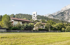 Houses of Gossen village. In Austria, you can see some peoples. Are the Alps mountains in the background royalty free stock photography