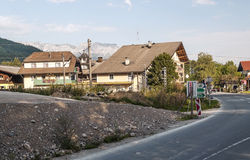 Houses of Gossen village. In Austria, you can see some peoples. Is an editorial image September 2015. mountains are the Alps in the background stock photo