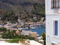 Houses on Greek Island of Kastellorizo/Meyisti. Colourful houses, shops, tavernas and boats on the waterfront of the Greek island of Kastellorizo or Meyisti stock images