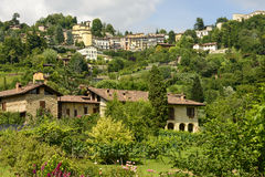 Houses on green hill and Borgo Canale neighbourhood, Bergamo Stock Image