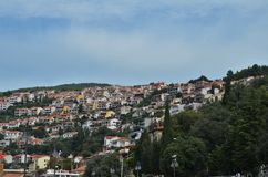 Houses on a green hill in Rabac in Croatia royalty free stock photography